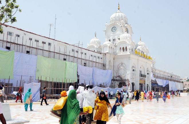 Work on the entrance area of the Golden Temple under way in Amritsar on Monday. Photo: Vishal Kumar